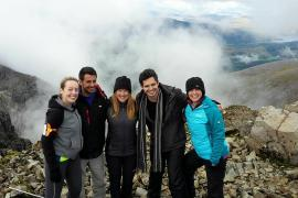 Happy climbers at the top of the three peaks