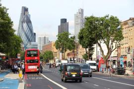 Tower hamlets. a 25 bus a black cab with the gherkin in the back